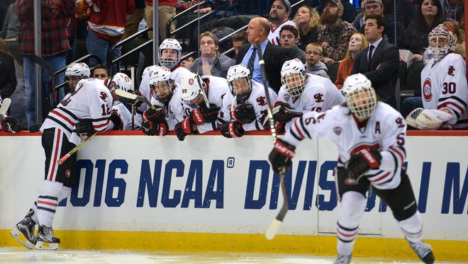 St. Cloud State players react to losing the NCAA Division 1 West Regional semifinal game 18 seconds into overtime Saturday, March 25, at the Xcel Energy Center in St. Paul. Ferris State's 5-4 victory over St. Cloud State in overtime ends the Huskies' run for title.