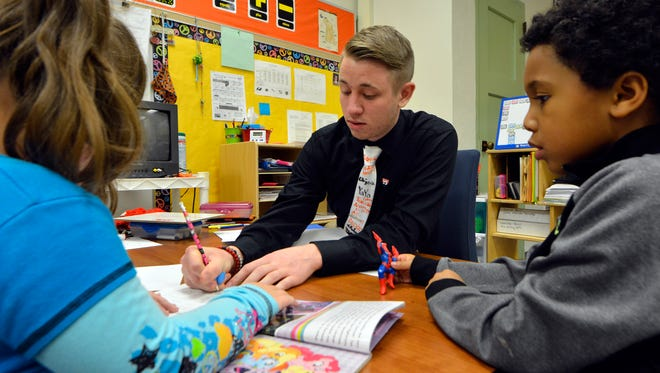 Student teacher Brian Baker works with students Bella Newman, left, and Hezekiah Ortiz in an autistic support class at Valley View Elementary School, Dec. 9, 2016. John A. Pavoncello photo