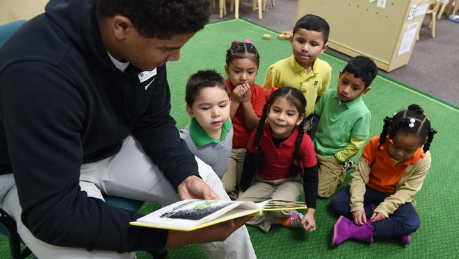 File photo of Brentwood Academy student Jordan McCoy as he reads to Nashville s Whitsitt Elementary Pre-K students during a community outreach day on Feb 1. Whitsitt Elementary is  on Tennessee's Priority School list.