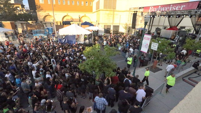 A crowd gathered in front of the main state on Santa Fe Street during a past El Paso Downtown Street Fest. The festival is moving to a different month.