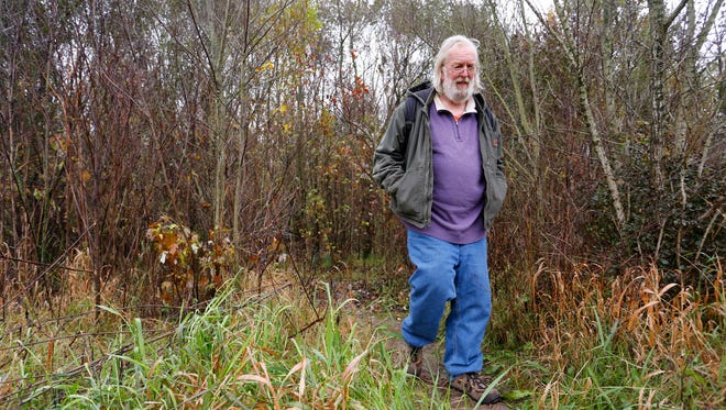 Steve Brackett emerges from the wood off the Wabash Heritage Trail south of Tapawingo Park Wednesday, November 15, 2017, in West Lafayette. Brackett was homeless for about two years between 2014 and 2015. He knew the area well, as he lived close by in the woods near the Wabash River.