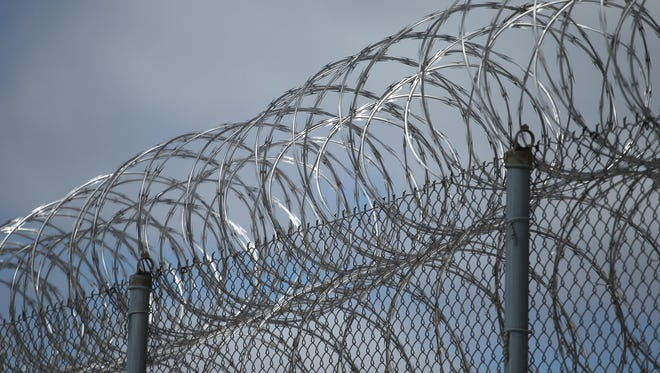 Razor wire tops one of the fences at the Lincoln Hills and Copper Lake schools complex in rural Irma in 2013.