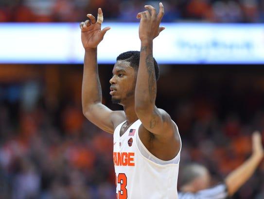 Syracuse Orange guard Frank Howard (23) gestures to