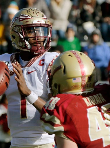 Florida State quarterback James Blackman looks for a receiver under pressure from Boston College defensive lineman Tanner Karafa in the first half of an NCAA college football game, Saturday, Nov. 9, 2019, in Boston. (AP Photo/Bill Sikes)