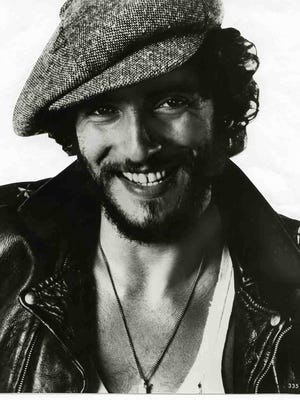 """Rock legend Bruce Sprinngsteen is seen in a 1975 publicity photo. His famous live version of """"Santa Claus is Coming to Town"""" was recorded the same year, though it was not released until 1981."""