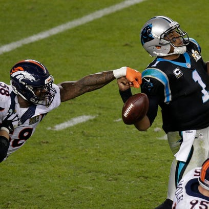 Denver's' Von Miller (58) strips the ball from Carolina's