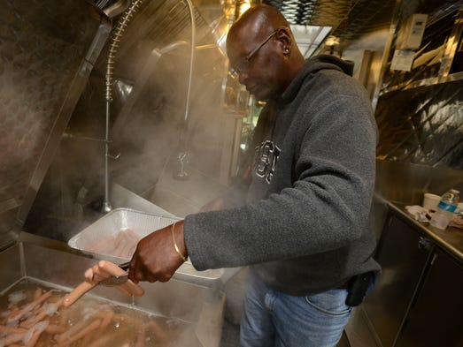 Salvation Army cook Willie Holiday makes hundreds upon hundreds of hot dogs inside one of the food trucks on Thursday to be delivered amongst the victims of the flood. Most of the homes in the area had major water damage inside from the flood waters on Tuesday night and Wednesday morning's storm.