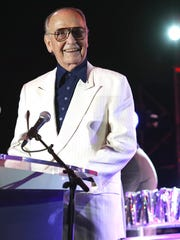 Jim Houston, recipient of the Jeanette Rockefeller Humanitarian Award, speaks during the Evening Under the Stars event at the O'Donnell Golf Course in Palm Springs, CA, Saturday, May 3, 2014.