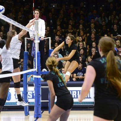 University of West Florida hitter Cora Bidlack puts the ball past Valdosta State blockers Tuesady at the UWF Field House.