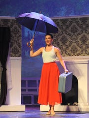 Mary Poppins, played by Brianna Barnes, arrives in