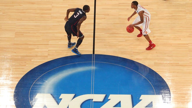 Iowa State's Monte Morris, right, brings the ball upcourt in last season's final game against Connecticut.