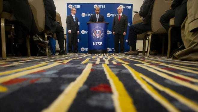 National Transportation Safety Board (NTSB) Acting Chairman Christopher A. Hart, center, with NTSB members Robert L. Sumwalt, left, and Earl F. Weener, right, answers questions regarding yesterday's subway incident during a NTSB news conference in Washington, Tuesday, Jan. 13, 2015. The transit network in the nation's capital, which is being investigated the incident, remains hobbled after an electrical malfunction that filled a busy subway station with smoke, killing one woman and sending dozens of people to hospitals. (AP Photo/Pablo Martinez Monsivais)