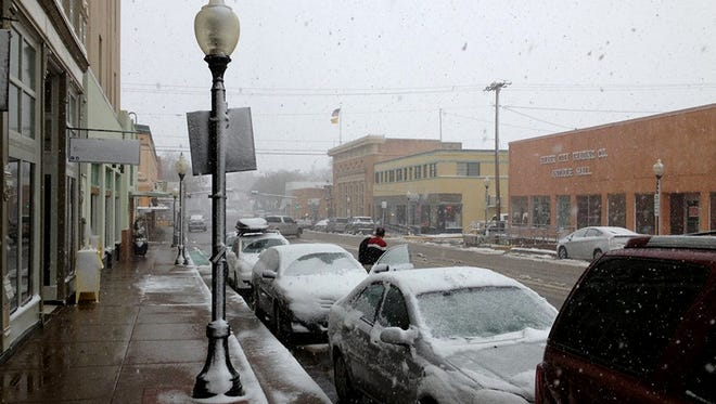 Snow blankets Broadway Street in Silver City on Monday. More winter weather and frigid temperatures are forecast for Tuesday.
