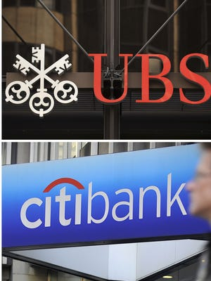 A combination of file pictures shows the logos of the Royal Bank of Scotland, (RBS) JP Morgan Chase, UBS, Citibank and HSBC.