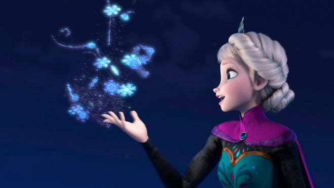 """This image released by Disney shows Elsa the Snow Queen, voiced by Idina Menzel, in a scene from the animated feature """"Frozen."""""""