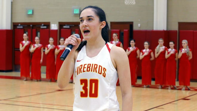 Chaparral High School basketball player Brenna Doyle sings the National Anthem prior to action against North Canyon High Wednesday, Jan. 25, 2017 in Scottsdale, Arizona.