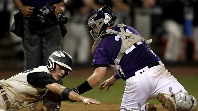 Mosinee catcher Matt Olson tags out a runner at the plate during the WIAA state baseball tournament last June. Olson is one of six players who saw playing time in last year's Division 2 semifinal loss to Waupun. Mosinee faces Jefferson in a state semifinal matchup on Wednesday.