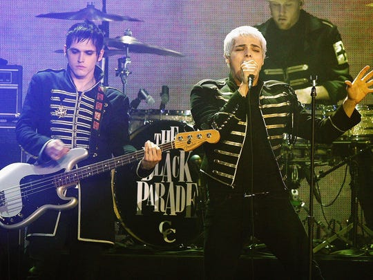 "Gerard Way (right) of My Chemical Romance performs onstage during Spike TV's ""Scream Awards 2006"" at the Pantages Theatre on Oct. 7, 2006, in Los Angeles, California."