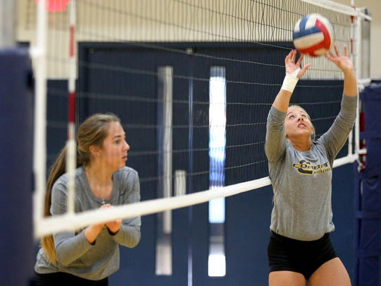 Corban setter Madison McLain during practice, Monday, October 26, 2015, at the C.E. Jefferson Sports Center in Salem, Ore.