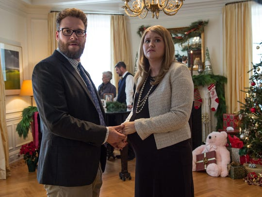"Seth Rogen, left, and Jillian Bell star in ""The Night Before."""