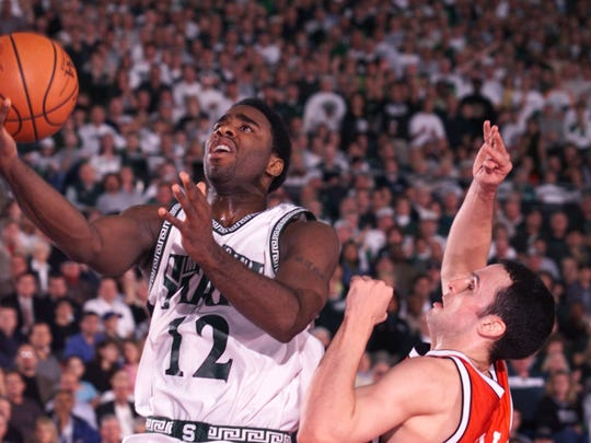 Mateen Cleaves #12 of Michigan State drives around Mike Kelley #22 of Wisconsin during the semifinal round of the NCAA Final Four at the RCA Dome in Indianapolis, Indiana.