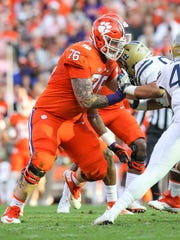 Clemson offensive lineman Sean Pollard blocks during
