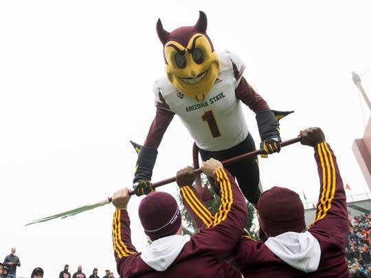 Arizona State Sun Devils mascot does push ups after