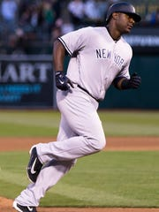 Yanks first baseman Chris Carter after hitting a solo home run against the A's in the sixth inning at Oakland on Friday.