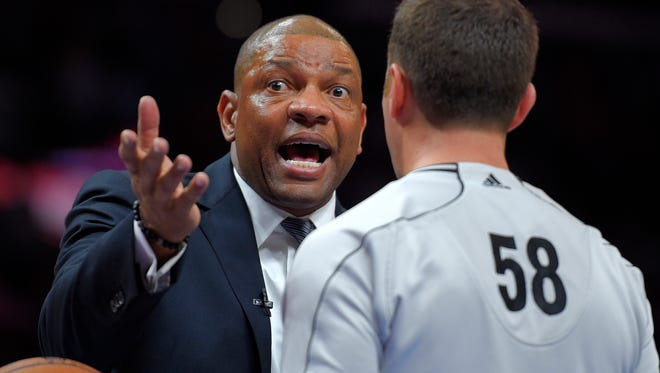 Clippers head coach Doc Rivers, left, argues with referee Josh Tiven during Game 5 against the Spurs.