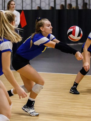 Mukwonago sophomore Erin Powers (14) bumps a serve during a match against Howards Grove in the Mizuno Charger Rally at the Milwaukee Sting Center on Saturday, Sept. 16, 2017.