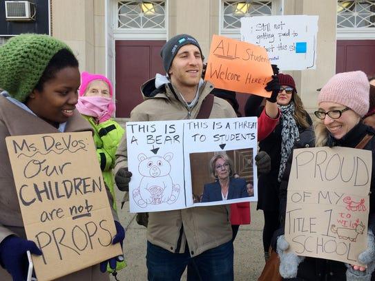 Protesters, including Ari Schwartz, center, gather