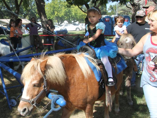A favorite of the festival, Ariayah Chitwood, 2, took part in the pony ride at the festival.