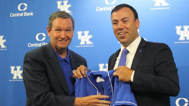 UK athletic director Mitch Barnhart, left, introduces new baseball coach Nick Mingione, right, at a news conference on June 14, 2016.
