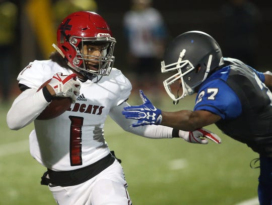Olympic's Jordan Quintero lunges for Archbishop Murphy's Kyler Gordon during Friday's game.