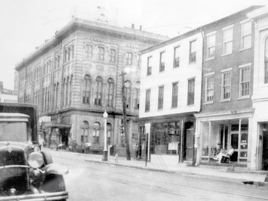 An undated early photo of Schupp's Barber Shop looking from in front of Hinkle's Pharmacy in Columbia.