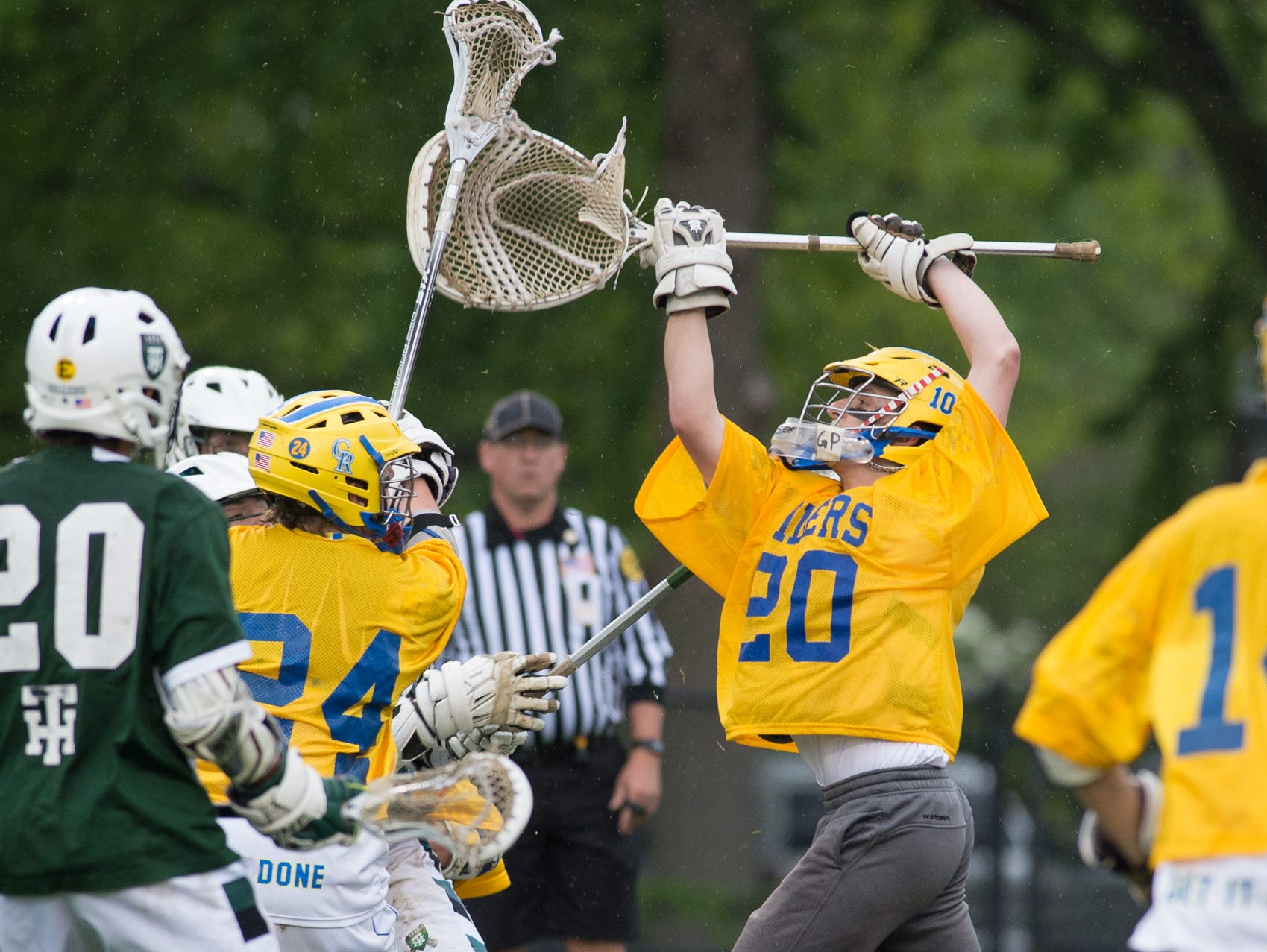 Caesar Rodney's goalie Tyler Gross reaches to stop a shot in their home game against Tower Hill.