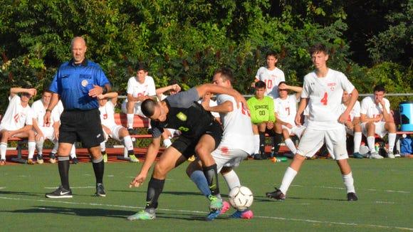 Lakeland's Carlos Del Monte battles for possession