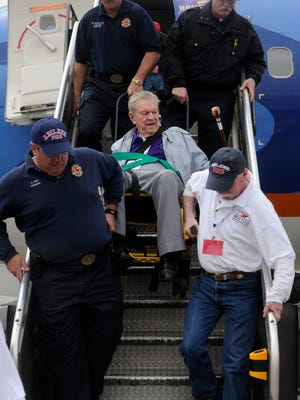 Ronald W. Erdrich/Reporter-NewsAbilene firefighters carry Noble Harris down the ramp of the 737 during Tuesday's West Texas Honor Flight Tuesday, April 12, 2011. The group of over 200 World War II vets were on a one-day, whirlwind tour of the WWII memorial in D.C.
