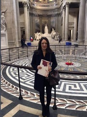 Britain's Catherine Norris Trent holds her document after a naturalization ceremony in Paris' Pantheon monument, Thursday, March 21, 2019. With the looming Brexit deadline, the 38-year-old mother of two who's lived in the French capital for over a decade was one of dozens of newly-minted French nationals attending the ceremony.