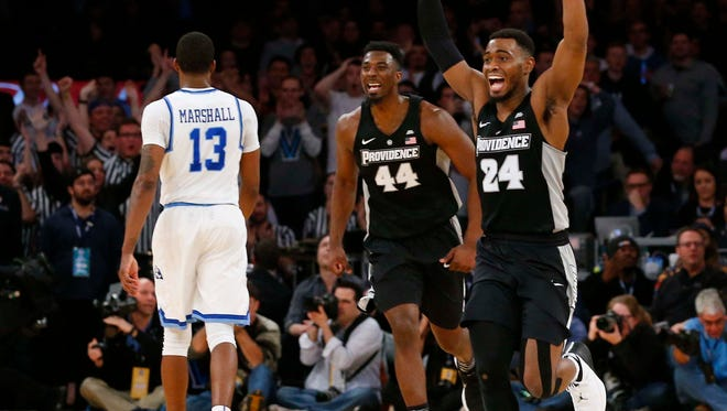 March 9: Providence guard Kyron Cartwright celebrates the Friars' victory over Xavier in overtime of their Big East tournament game at Madison Square Garden in New York.
