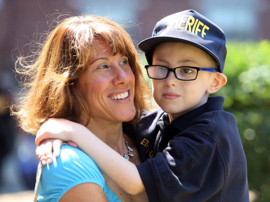 Ethan Geller, 7, with mom Lisa as Ethan is honored as 'hero for a day' by the Morris County Sheriff's Office. Atlantic Health Systems/Goryeb Children's Center and the Sheriff's Office collaborated in showing Ethan around the courthouse and sheriff's office. June 24, 2016, Morristown, NJ