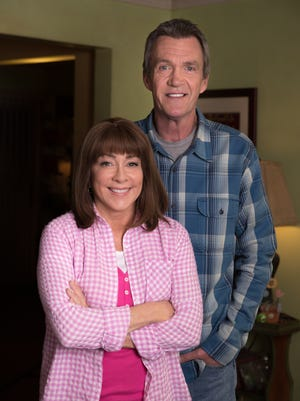 "Patricia Heaton, left, and Neil Flynn, who play Frankie and Mike Heck on ""The Middle,"" pose in the Heck's living room on the second-to-last day of shooting."