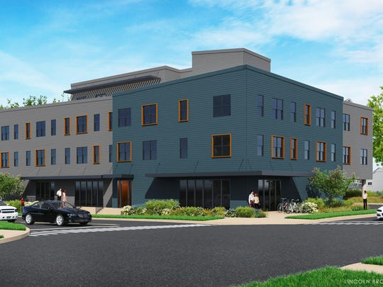 An artists rendering of a commercial and residential building proposed for Pine Street and Flynn Avenue, where the Pine Street Deli currently stands.