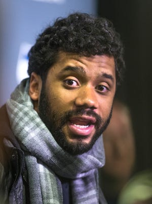 Seattle Seahawks quarterback Russell Wilson answers questions from the media during a press conference after the team's arrival at the Arizona Grand Resort Sunday afternoon.  The team flew in from Seattle, arriving at around 2:20 pm.