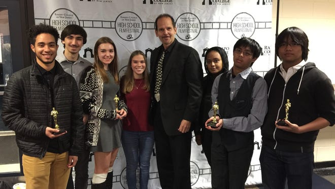 Three short films by Bloomfield High School students were among those shown at a high school film festival at Ramapo College on Dec. 3-4. From left: Rafael Scafuro, Christopher Jeffer, Madelaine Haney, Justine Dubreuil, teacher David Simonetti, Allah Rahama, Josh Perez and James Camarillo. The participating students also included Jerimiah Griffin and David Broderick.