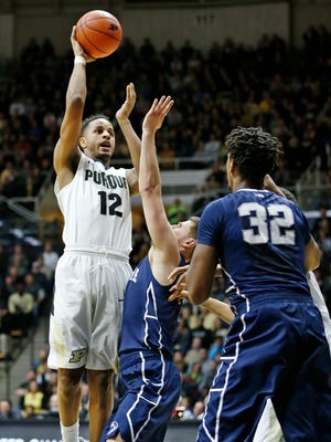 Vince Edwards with a shot over the Penn State defense Wednesday, January 13, 2016, at Mackey Arena. Purdue defeated Penn State 74-57.