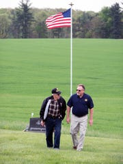 Mitchell Stambaugh, right, father of Army Pfc. Cameron Stambaugh walks with Cameron's grandfather Quentin Stambaugh, age 94, on May 9, 2016 at Cameron's grave site at Trinity Roth's U.C.C. in Jackson Township. Mitchell Stambugh had a flag pole placed at the site that he can easily see on the way to work.