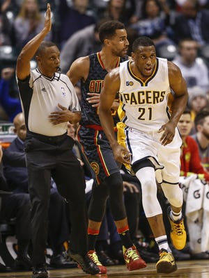 Indiana Pacers forward Thaddeus Young (21) runs back to play defense after making a three-point shot against the Atlanta Hawks in the first half at Bankers Life Fieldhouse on Wednesday, Nov. 20, 2016.