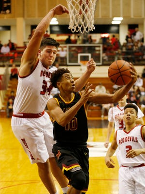 George Karlaftis of West Lafayette tries to stop a shot by Robert Phinisee of McCutcheon in the Franciscan Health Hoops Classic semifinal Friday, December 1, 2017, at Lafayette Jeff. West Lafayette defeated McCutcheon 57-53 to advance to the championship on Saturday.