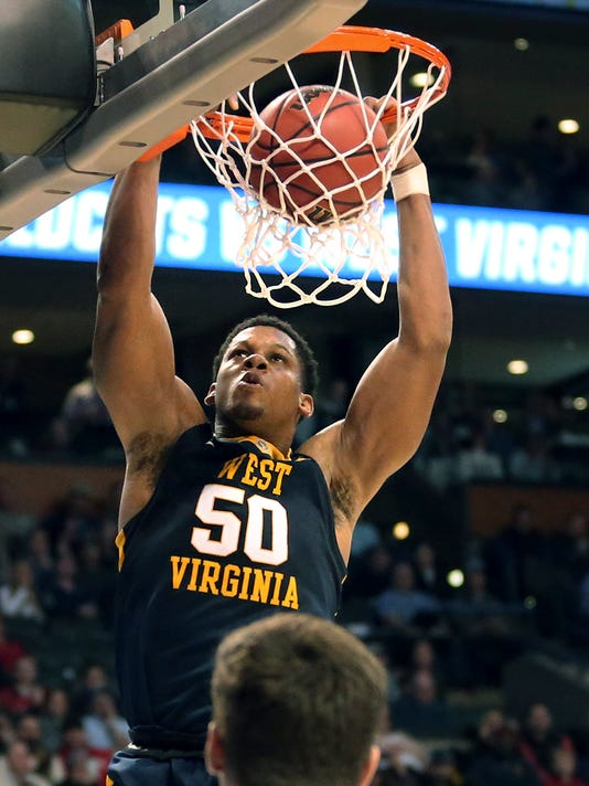 West Virginia's Sagaba Konate dunks against Villanova during the first half of an NCAA men's college basketball tournament regional semifinal Friday, March 23, 2018, in Boston. (AP Photo/Mary Schwalm)